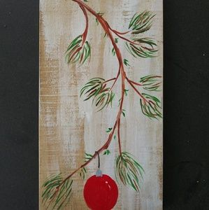 Painting on reclaimed pallet wood.